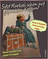 FW-merkel-gepackte-koffer-py_626x762